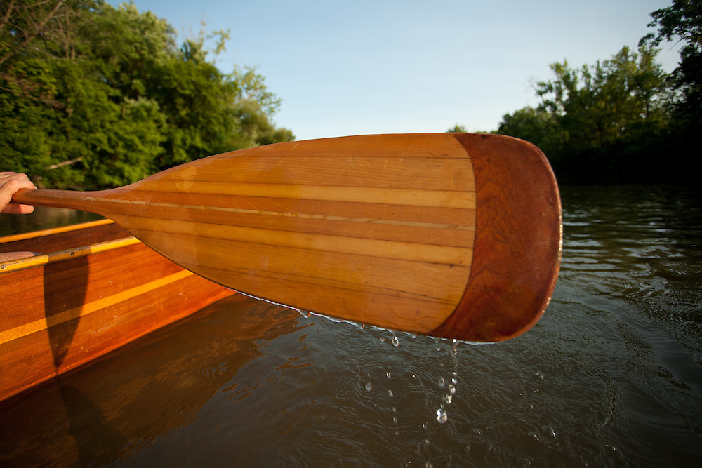 A fly fisherman paddles his handmade wooden canoe on the Olentangy River in central Ohio.