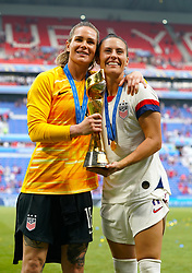 USA goalkeeper Ashlyn Harris (left) and USA's Ali Krieger celebratw with the trophy after winning the FIFA Women's World Cup 2019