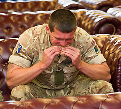 Pictured: Fusiler Michael Wardrope enjoys a welcome bacon buttie<br /> <br /> 2 SCOTS arriving home from Iraq deployment. OP Shader troops from The Royal Highland Fusiliers, 2nd Battalion The Royal Regiment of Scotland have been training local forces since December 2017. The troops have been training the local Iraqi forces for the last six months<br /> <br /> <br /> Ger Harley | EEm 19 June 2018