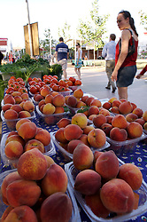 Stock photo of peaches and tomatoes at the organic farmer's market in the park