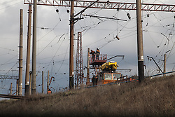 Workers in Debaltsevo work on restoring and repairing the overhead power cables of the railway lines that pass through this important rail hub in eastern Ukraine. The city is slowly recovering following momnths of fighting that detsroyed much of it's infra structure and many of the homes of its residents.
