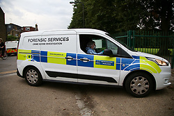 © Licensed to London News Pictures. 24/08/2020. London, UK. A forensic officer drives in St James Park, Walthamstow, East London as detectives launch an investigating following the discovery of a man's body. Police were called by a member of the public at approximately 13:40hrs to St James Park, E17, after a person was found unresponsive. A man, aged in his thirties, was pronounced dead at the scene. Photo credit: Dinendra Haria/LNP
