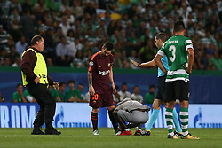 September 27, 2017 - Lisbon, Lisbon, Portugal - Barcelonas forward Lionel Messi from Argentina with a supporters that invade the pitch during the match between Sporting CP v FC Barcelona UEFA Champions League playoff match at Estadio Jose Alvalade on September 27, 2017 in Lisbon, Portugal. (Credit Image: © Dpi/NurPhoto via ZUMA Press)