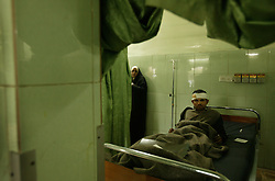 Sa'ad Shalage, 27, a would-be army recruit, waits for further treatment at Al Yarmouk hospital, Baghdad, Iraq, Feb. 11, 2004. A suicide attacker detonated a car packed with explosives in a crowd of hundreds of Iraqis waiting outside a Baghdad army recruiting center Wednesday, killing up to 46 people in the second bombing in two days targeting Iraqis working with the U.S.-led coalition. The attack backed threats that insurgents would step up violence to disrupt the planned June 30 handover of power to the Iraqis.