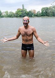© Licensed to London News Pictures. 31/08/2018. London, UK.  A participant celebrates as he finishes the Tidal River Swim in Hammersmith this evening, launching this years Thames Festival. Over 100 brave enthusiasts took part in a 30 minute swim, as they followed the tide towards Chiswich Eycot and back. Photo credit: Vickie Flores/LNP