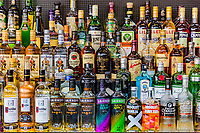 Vodkas Rhum Gin Alcohol liquors  drinks bottles on a bar stand
