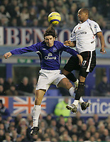 Photo: Dave Howarth.<br /> Everton v Charlton Athletic. The Barclays Premiership.<br /> 02/01/2005.  Charlton's Shaun Bartlett out jumps Everton's Nuno Valente