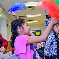 """011615       Cable Hoover<br /> <br /> Antonio Montes, right, and other participants wave colored scarves while singing along to """"This Little Light of Mine"""" during the Martin Luther King day celebration at the Gallup Children's Library Saturday. The children's gospel song was a popular refrain during many of King's civil rights demonstrations."""