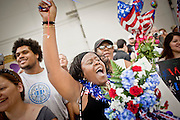 16 JUNE 2010 - PHOENIX, AZ: Nicole Ramseur cheers as returning soldiers march into the 161st Air Refueling Wing hangar at Sky Harbor Airport in Phoenix Wednesday. Members of the 3666th Maintenance Company of the Arizona Army National Guard returned to Phoenix Wednesday after serving in Iraq (CQ).   PHOTO BY JACK KURTZ