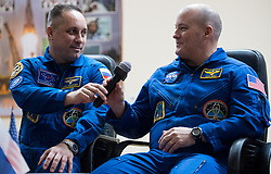 Expedition 54 Soyuz Commander Anton Shkaplerov of Roscosmos, left, passes a microphone to flight engineer Scott Tingle of NASA, right, while answering a question during a press conference, Saturday, December 16, 2017 at the Cosmonaut Hotel in Baikonur, Kazakhstan. Expedition 54 Soyuz Commander Anton Shkaplerov of Roscosmos, flight engineer Scott Tingle of NASA, and flight engineer Norishige Kanai of Japan Aerospace Exploration Agency (JAXA) are scheduled to launch to the International Space Station aboard the Soyuz spacecraft from the Baikonur Cosmodrome on December 17. Photo by Joel Kowsky / NASA via CNP/ABACAPRESS.COM