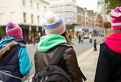 Back View of Teenage Girls Walking on a London Street