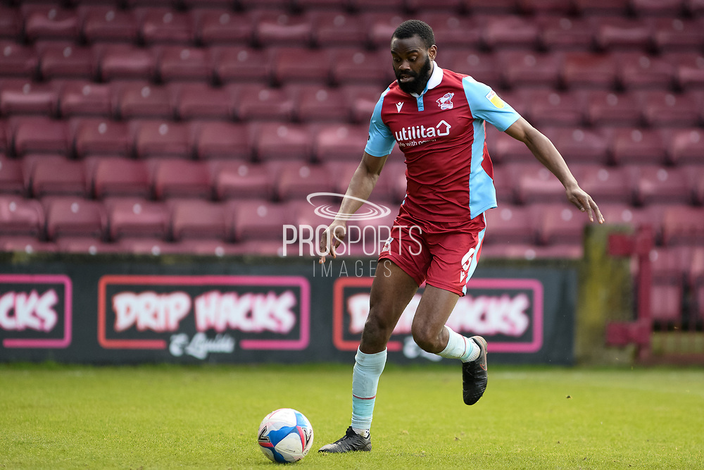 Scunthorpe United Emannuel Onariase (6) on the ball full length portrait during the EFL Sky Bet League 2 match between Scunthorpe United and Grimsby Town FC at the Sands Venue Stadium, Scunthorpe, England on 23 January 2021.
