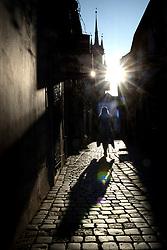 March 23, 2019 - Znojmo, Czech Republic - Woman walking down the street at sunset in Znojmo in Southern Moravia in the Czech Republic. (Credit Image: © Slavek Ruta/ZUMA Wire)