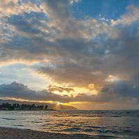 The sun sets over the northwest coast of Oahu, Hawaii.
