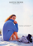 Nicole wraps herself into her soft, blue cashmere sweater on a sugar soft sand beach in South Carolina. This photogaph was shot for Boston Proper.