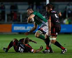 Benetton Treviso's Braam Steyn evades the tackle of Dragons' Lloyd Fairbrother<br /> <br /> Photographer Simon King/Replay Images<br /> <br /> Guinness PRO14 Round 1 - Dragons v Benetton Treviso - Saturday 1st September 2018 - Rodney Parade - Newport<br /> <br /> World Copyright © Replay Images . All rights reserved. info@replayimages.co.uk - http://replayimages.co.uk