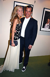 MATTHEW MELLON and NOELLE RENO at a party to launch the One T-Shirt by Edun held at Harvey Nichols, Knightsbridge, London on 18th October 2006.<br /><br />NON EXCLUSIVE - WORLD RIGHTS