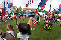 Annual Multcultural Day's parade of flags in Rotary Park.  (Karen Bobotas/for the Laconia Daily Sun)