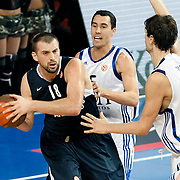 Efes Pilsen's Nikola VUJCIC (L) and Real Madrid's Pablo PRIGIONI (C) during their Turkish Airlines Euroleague Basketball Top 16 Group G Game 4 match Efes Pilsen between Real Madrid at Sinan Erdem Arena in Istanbul, Turkey, Thursday, February 17, 2011. Photo by TURKPIX