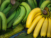 01 DECEMBER 2016 0 BANGKOK, THAILAND: Bananas ripe (right) and unripe (left) at the traditional market on Lan Luang Road in Bangkok. The market is on the site of one of the first western style cinemas in Bangkok. The movie theatre closed years ago and is still empty but the market fills the streets around the theatre.     PHOTO BY JACK KURTZ