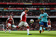 Mesut Ozil of Arsenal shoots at goal under pressure from Nathan Ake of AFC Bournemouth.  Premier league match, Arsenal v AFC Bournemouth at the Emirates Stadium in London on Saturday 9th September 2017. pic by Kieran Clarke, Andrew Orchard sports photography.