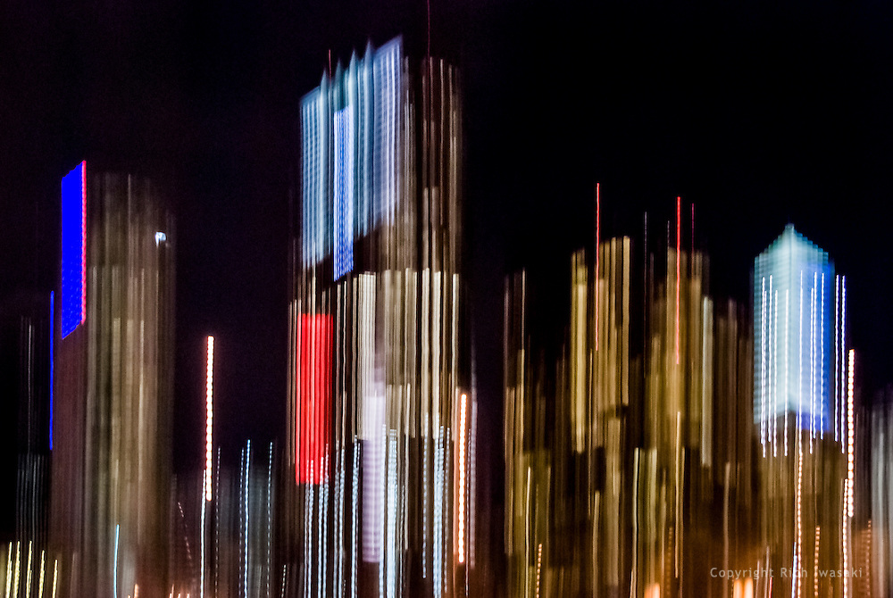Blurred motion view of office buildings at night, Tampa, Florida