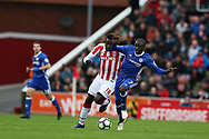 N'Golo Kante of Chelsea is challenged by Mame Diouf of Stoke city. Premier league match, Stoke City v Chelsea at the Bet365 Stadium in Stoke on Trent, Staffs on Saturday 18th March 2017.<br /> pic by Andrew Orchard, Andrew Orchard sports photography.