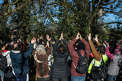 Harefield, UK. 8 February, 2020. Environmental activists from Save the Colne Valley, Stop HS2 and Extinction Rebellion form a food circle to celebrate their prevention of HS2 engineers from carrying out tree felling works scheduled for the high-speed rail project this weekend.