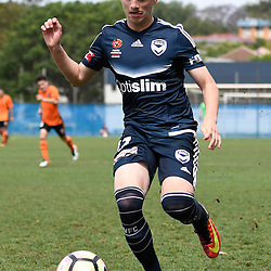 BRISBANE, AUSTRALIA - NOVEMBER 12: Aleksandar Stanisavljevic of the Victory dribbles the ball during the round 1 Foxtel National Youth League match between the Brisbane Roar and Melbourne Victory at Spencer Park on November 12, 2016 in Brisbane, Australia. (Photo by Patrick Kearney/Brisbane Roar)