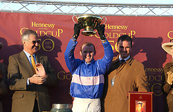 Left to right, MAURICE HENNESSY , jockey of State of Play winner of the 2006 Hennessy Gold Cup PAUL MOLONEY and trainer EVAN WILLIAMS at the 50th running of the Hennessy Gold Cup at Newbury Racecourse, Berkshire on 25th November 2006.<br />