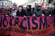 Masked demonstrators gather for the 'Oppose Tommy Robinson, unite against racism & fascism' counter demonstration organised for anti-fascist groups opposed to far right politics, regardless of their positions on leave/remain on Brexit on 9th December 2018 in London, United Kingdom.