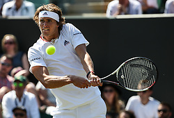 July 3, 2018 - London, England, United Kingdom - Alexander Zverev of Germany returns a hit during the men's singles first round match against James Duckworth of Australia at the Championship Wimbledon 2018 in London, Britain, on July 3, 2018. Alexander Zverev won 3-0. (Credit Image: © Tang Shi/Xinhua via ZUMA Wire)
