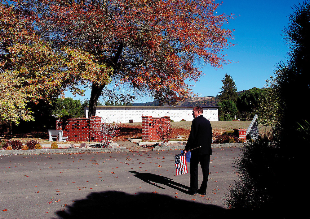 Funeral director Cory Mullenaux walks the grounds before Marine Lance Cpl. Derek Jones, a Sprague graduate killed in Iraq on Oct. 8, is buried at Restlawn Funeral Home.