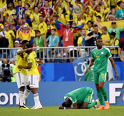 SAMARA, June 28, 2018  Salif Sane (2nd R) of Senegal kneels on the pitch after the 2018 FIFA World Cup Group H match between Colombia and Senegal in Samara, Russia, June 28, 2018. Colombia won 1-0 and advanced to the round of 16. (Credit Image: © Chen Cheng/Xinhua via ZUMA Wire)