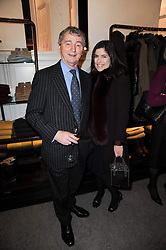 STEPHEN QUINN and his wife KIMBERLEY at a party to celebrate the publication of Dogs in Vogue by Judith Watt held at James Purdey & Sons, Audley House, 57-58 South Audley Street, London W1 on 3rd December 2009.