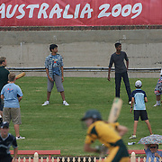 Fans play cricket on the hill during the Australia V New Zealand group A match at North Sydney Oval in the ICC Women's World Cup Cricket Tournament, in Sydney, Australia on March 8, 2009. New Zealand beat Australia by 13 runs in the (D/L method)  rain affected match. Photo Tim Clayton