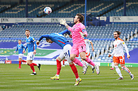Football - 2020 / 2021 Sky Bet League One - Portsmouth vs. Blackpool - Fratton Park<br /> <br /> Chris Maxwell of Blackpool collides with Portsmouth's Ronan Curtis causing the Portsmouth player to appeal for a penalty during the League One fixture at Fratton Park <br /> <br /> COLORSPORT/SHAUN BOGGUST