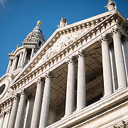 Looking up at the front of St Paul's Cathedral, one of the most distinctive of London's landmarks. There has been a church on this site since 604 AD. The current building, with it's massive dome, was designed by Christopher Wren and dates back to the late 17th century.