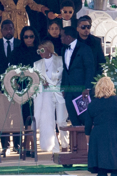 Music mogul Diddy holds hands with singer Mary J Blije as they arrive at the memorial gardens where former girlfriend Kim Porter, the mother of three of his children, will be laid to rest. Mourners arrived at Evergreen Memorial Park After the funeral service at Cascades Hills Church in the former model's hometown of Columbus, Georgia. Diddy overcame his grief to deliver a moving eulogy. Others who gave eulogies included Blige, Dallas Austin, Bishop Noel Jones and Porter's son, actor and singer Quincy Brown. Quincy broke down as he spoke and was joined at the mic by his father, Al B. Sure!, and Diddy. The service was packed with celebrities including best friend Kimora Lee Simmons, Missy Elliot, Lil Kim, Tichina Arnold, NeNe Leakes, Fat Joe, Kandi Burress, Winnie Harlow, Ryan Destiny, Stevie J and more. Porter died after suffering from a bout of pneumonia but her exact cause of death is unknown. She was just 47. Diddy, 49, and Porter were together, off and on, for 10 years, and although they were no longer a couple, they were still close, sharing three children: son Christian, 20, and twin daughters D'Lila Star and Jessie James, who turn 12 next month. They also raised 27-year-old Quincy Brown, Porter's son with singer and record producer Al B. Porter died at her Los Angeles home on Nov. 15. An autopsy was performed the next day but the results were deferred for further testing, which could take weeks. 24 Nov 2018 Pictured: P Diddy and Mary J Blije. Photo credit: MEGA TheMegaAgency.com +1 888 505 6342