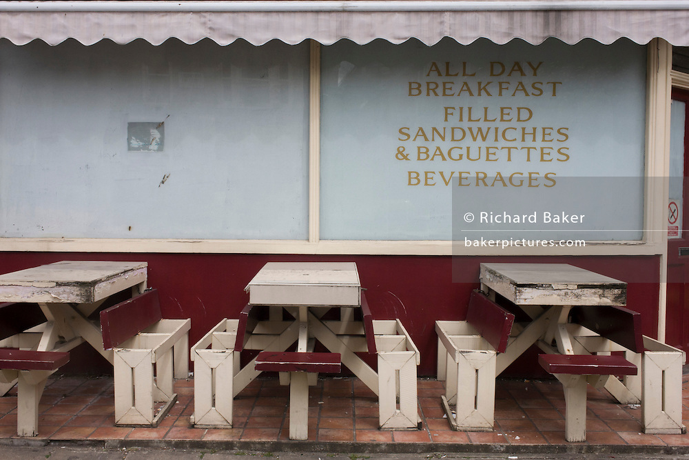 A closed cafe that once offered all day breakfast with empty seating in central London, a victim of the UK recession.