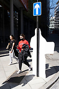 The reverse side of a construction site warning sign appears as a white human shape during the third lockdown of the Coronavirus pandemic, on 29th March 2021, in London, England.