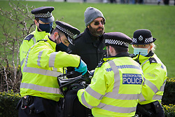 © Licensed to London News Pictures.06/01/2021, London, UK. Police seize an anti-lockdown protestor at Parliament Square as the second day of the 3rd national Covid-19 lockdown continues. Photo credit: Marcin Nowak/LNP