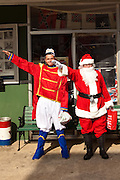 Santa Claus and the tin soldier give a Nazi salute outside the Redneck Shop December 5, 2009 in Laurens, SC during the 7th Annual White Unity Christmas Party held by the American Nazi Party & International Knights of the Ku Klux Klan.