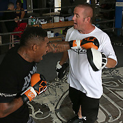 """WINTER HAVEN, FL - MAY 05: Boxer Willie Monroe Jr. (L) hits the mitts with trainer Tony Morgan at the Winter Haven Boxing Gym on May 5, 2015 in Winter Haven, Florida. Monroe will challenge middleweight world champion Gennady """"GGG"""" Golovkin for the WBA world championship title in Los Angeles on May 16.  (Photo by Alex Menendez/Getty Images) *** Local Caption *** Willie Monroe Jr.; Tony Morgan"""
