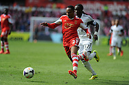 Southampton's Nathaniel Clyne (l) holds off Swansea's Marvin Emnes. Barclays Premier league match, Swansea city v Southampton at the Liberty stadium in Swansea, South Wales on Saturday 3rd May 2014.<br /> pic by Andrew Orchard, Andrew Orchard sports photography.
