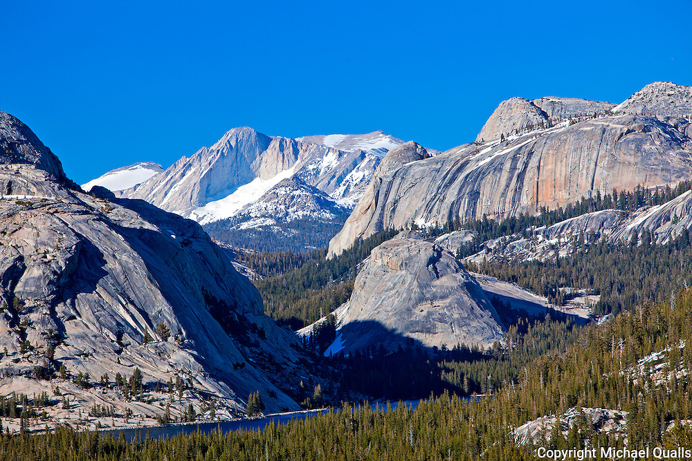 As the sun is going down - Tenaya Lake and Mt. Conness as seen from the knoll below Olmstead point.  Yosemite, CA.  USA