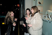 MATILDA STURRIDGE; ALBA HODSALL, The Way We Wore.- Photographs of parties in the 70's by Nick Ashley. Sladmore Contemporary. Bruton Place. London. 13 January 2010. *** Local Caption *** -DO NOT ARCHIVE-© Copyright Photograph by Dafydd Jones. 248 Clapham Rd. London SW9 0PZ. Tel 0207 820 0771. www.dafjones.com.<br /> MATILDA STURRIDGE; ALBA HODSALL, The Way We Wore.- Photographs of parties in the 70's by Nick Ashley. Sladmore Contemporary. Bruton Place. London. 13 January 2010.