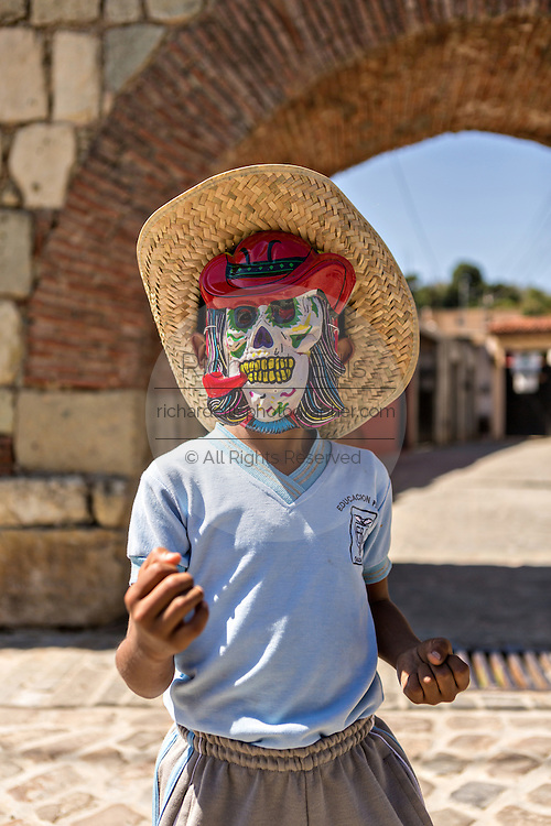 A young boy dressed as a skeleton during the Day of the Dead Festival known in spanish as Día de Muertos November 4, 2014 in Oaxaca, Mexico.