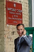 Moscow, Russia, 23/08/2004..Scnes outside the court where former Yukos CEO Mikhail Khodorkovsky and business associate Platon Lebedev face charges of fraud, embezzlement and tax evasion. Anton Drel, one of Khodorkovsky's lawyers, speaking on a mobile phone on the court steps.