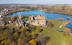 Aerial view of Linlithgow Palace, St Michaels's Parish Church beside Linlithgow Loch in West Lothian, Scotland, Uk